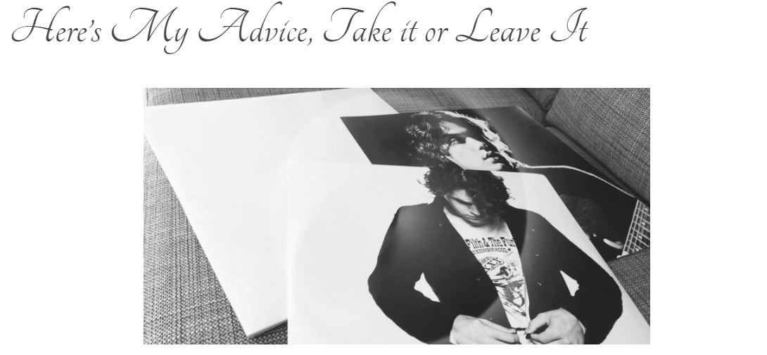 "Screen grab of blog title page: ""Here's My Advice, Take It of Leave It"" with black and white photo of John Mayer records strewn across a grey sofa."