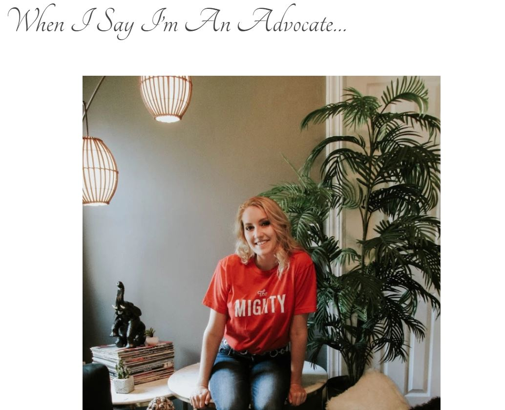 "Screen grab of blog title page: ""When I Say I'm An Advocate..."" with photo of blonde girl wearing a red t-shirt that says ""The Mighty"" surrounded by plants and a stack of old vinyl records."