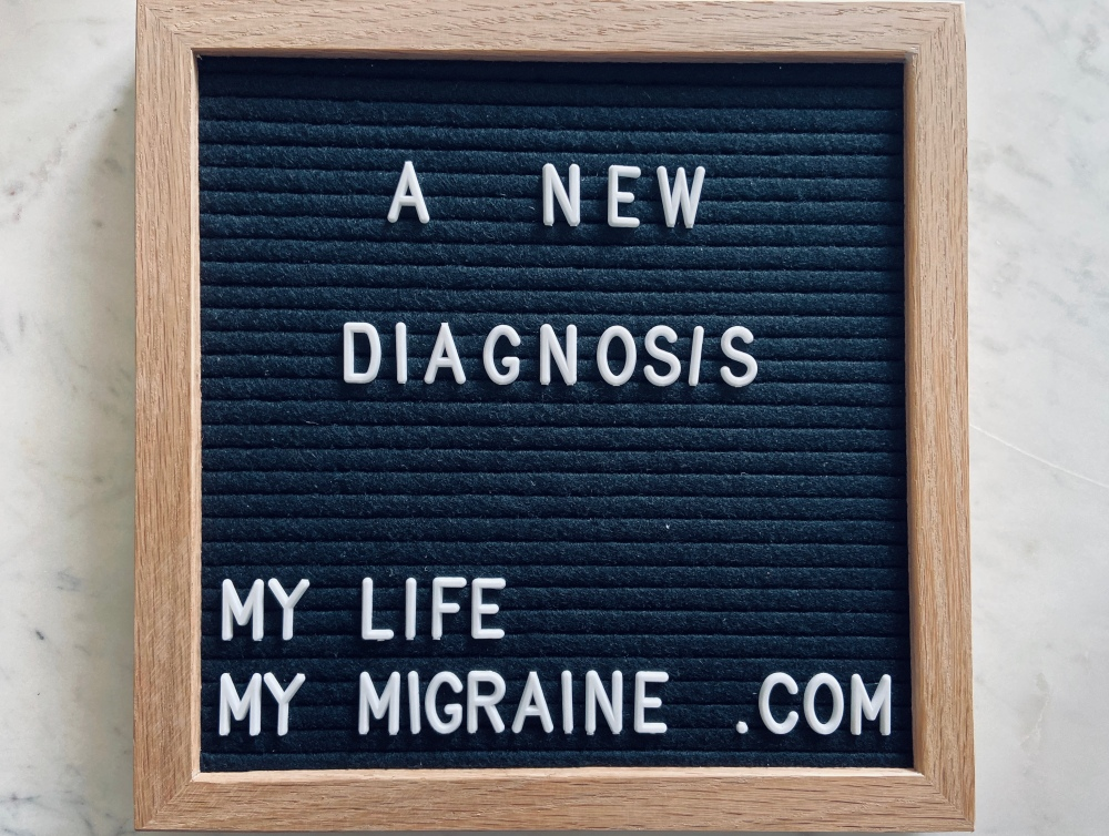 "Black felt board spelling out ""a new diagnosis"""