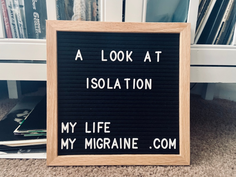 "black felt board with ""a look at isolation"" in white lettering. Background is of a record cabinet with various old vinyls leaning against the shelves."