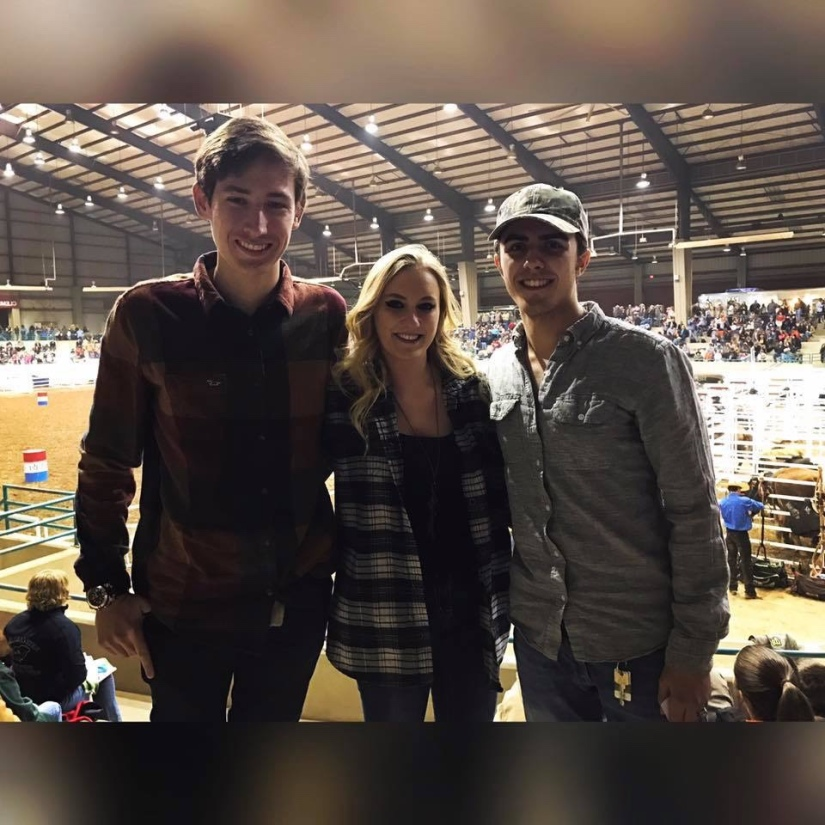 Girl in a flannel shirt with two gentlemen at a rodeo.