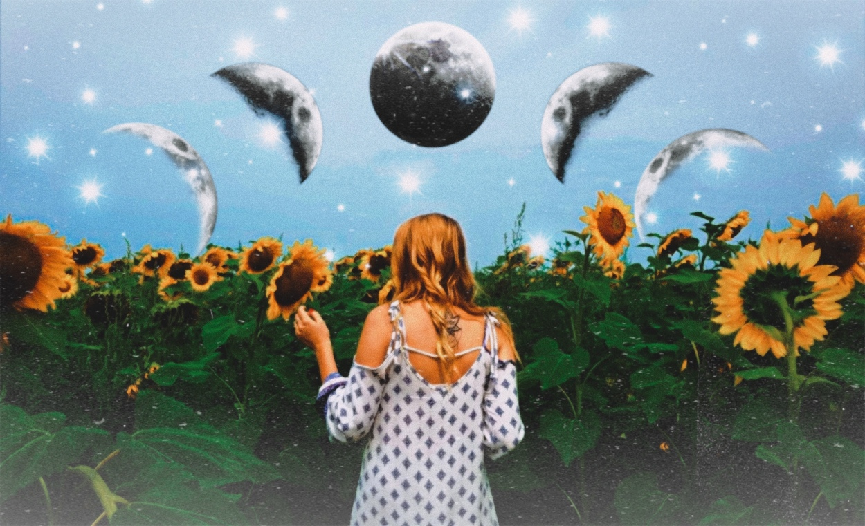 photo of blonde girl in white dress facing a sunflower field. above her is the moon in various phases, directly above her head is the full moon.