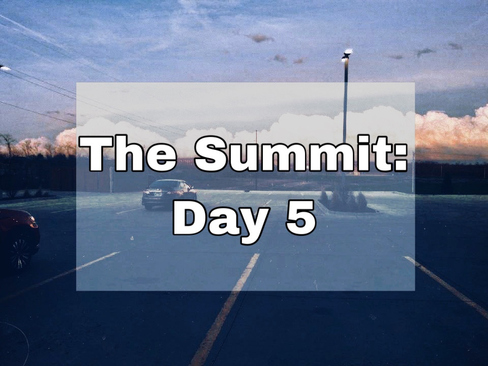 """Parking lot with large puffy white clouds in the distance with text overlay """"The Summit: Day 5"""""""