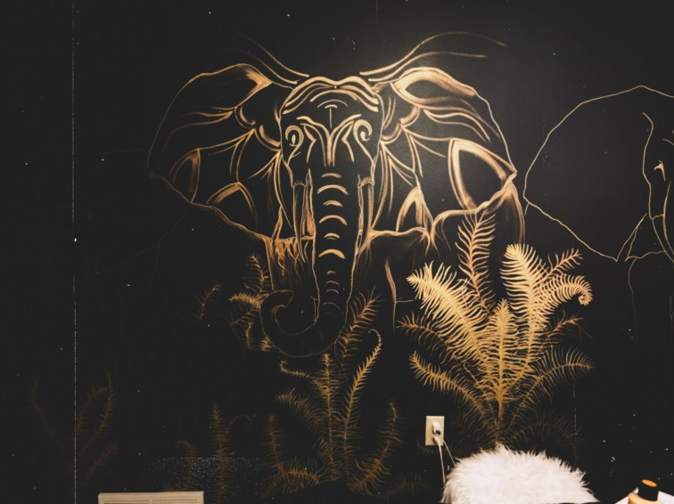 Gold elephant mural with abstract lines